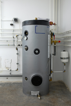 Boiler and pipes of the heating system of a house Archivio Fotografico
