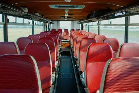 Bus interior of on old vehicle Imagens