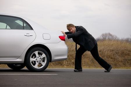 Pushing a broken down car