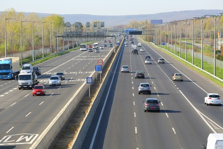 Highway with cars passing by Archivio Fotografico