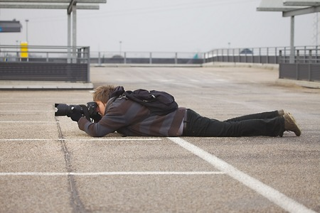 Photographer taking shots in the street Stock Photo