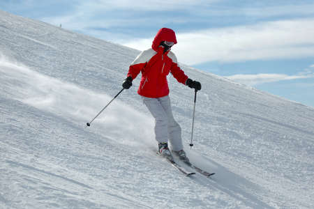 Female skier coming down the slope