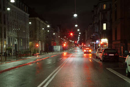 Urban street at night with little traffic Stok Fotoğraf