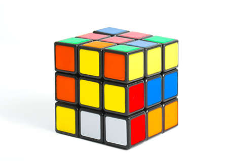 BUDAPEST, HUNGARY - MAY 1, 2016: Unsolved Rubiks cube logic game on white studio background