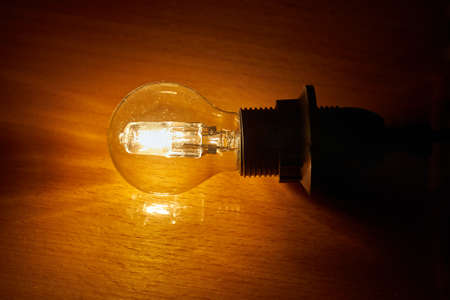 Light bulb on a table Stock Photo