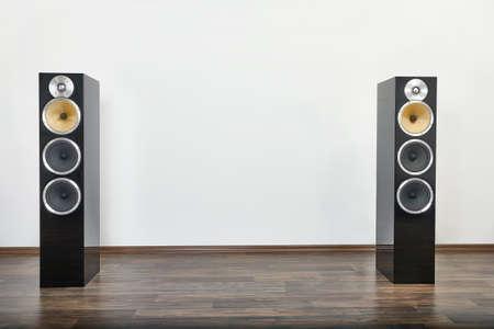 A pair of Hi-fi Speakers on a wooden floor