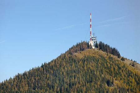 Transmitter towers on a hill Stock Photo