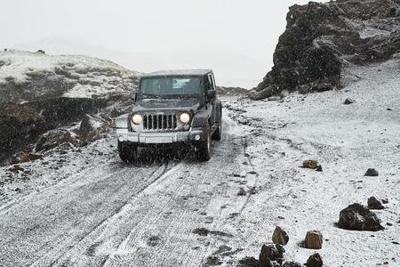Jeep Wrangler on Icelandic terrain with snow Redakční