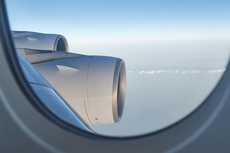 Flying on a plane, jet engines Stock Photo