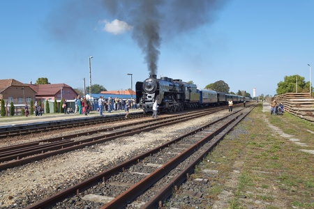 Steam locomotive at station Editorial