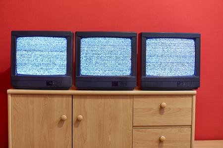 Three old TV sets