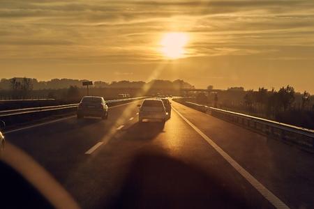 Driving in sunset Stock fotó - 118848192