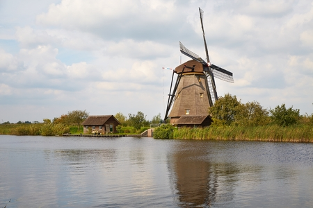 Windmill beside a canal
