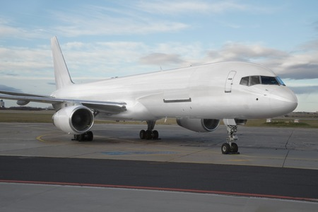 Airliner on the ground, freighter plane with blank white paintwork