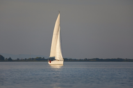 Sailing boat in dusk light