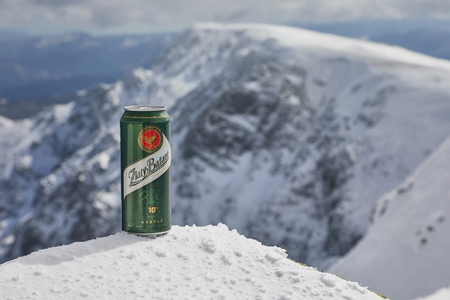 A can of Zlaty Bazant beer on a mountain