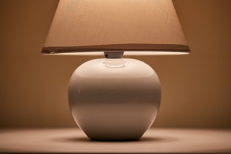 Lamp on a nightstand Standard-Bild