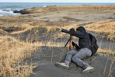 Photographer in Iceland, black sand beach