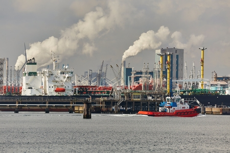 Industrial port and facilities smoking in the background
