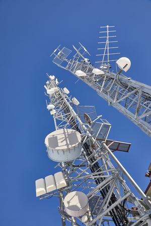 Transmitter towers, blue sky Фото со стока - 133409787