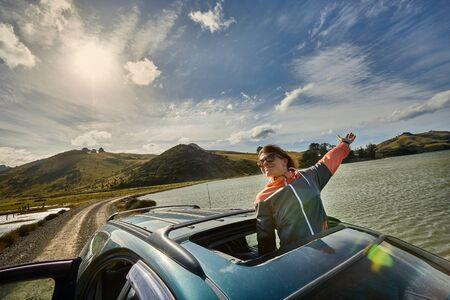 Car journey enjoying sunroof in the countryside 版權商用圖片
