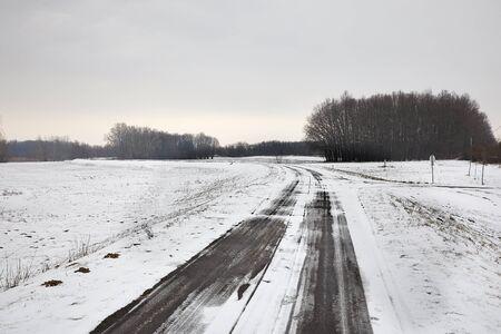 Rural road in snow in winter Archivio Fotografico