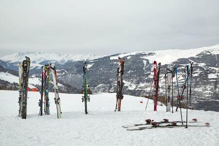 Skis on top of the slopes