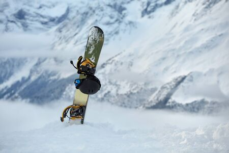 Snowboard high up in the snowy Alps