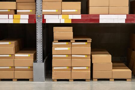 Warehouse stocked with boxes in stacks