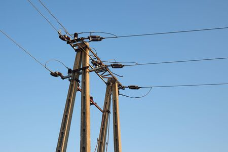 Electric lines overhaead, power line against bles sky