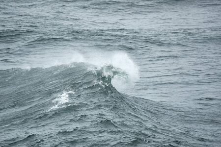 Extremely strong waves in the wind, stormy gust