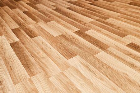 Shiny wooden floor reflecting light Фото со стока
