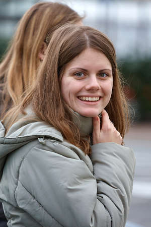 Portrait of a young woman on a street Stock fotó
