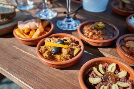 Tapas served in many small plates Standard-Bild
