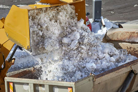 Loader removing snow from street Stockfoto