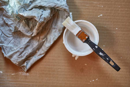 Paint brush on a can of white wall paint