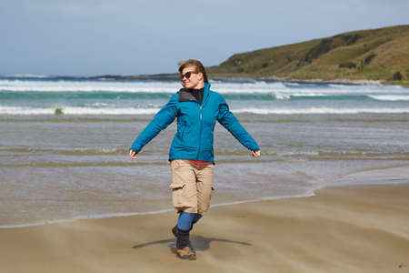 Womane injoying seaside wind