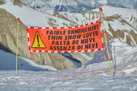 Ski warning sign for lack of snow Фото со стока