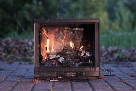 TV burning with broken screen Reklamní fotografie