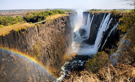 zimbabwe: Victoria Falls. A general view with a rainbow. National park. Mosi-oa-Tunya National park.
