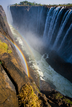 Victoria Falls. A general view with a rainbow. National park. Mosi-oa-Tunya National park.