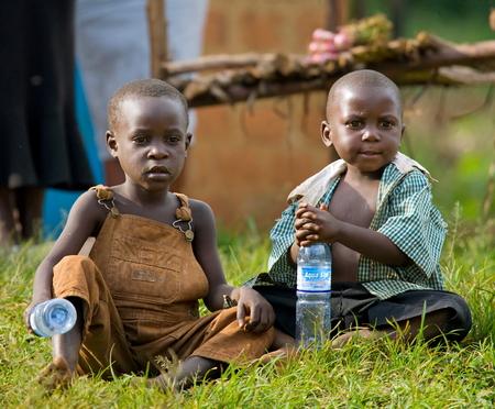 kisoro: KISORO, UGANDA, AFRICA - DECEMBER 12, 2008: Kisoro. Uganda. Africa. Village children are sitting at the roadside. Editorial