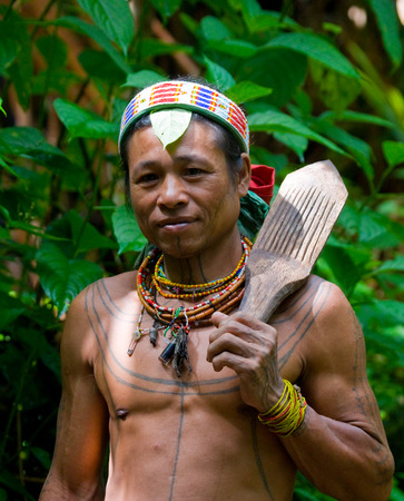 ancients: MENTAWAI PEOPLE, WEST SUMATRA, SIBERUT ISLAND, INDONESIA - 16 NOVEMBER 2010: Portrait of a man Mentawai tribe in traditional headdress.