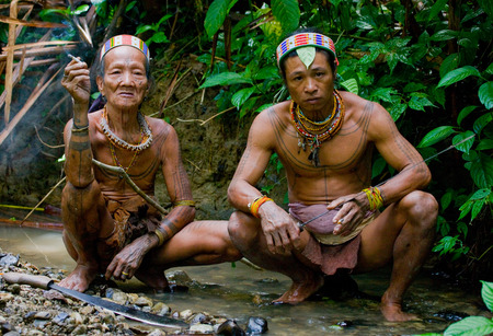 MENTAWAI PEOPLE, WEST SUMATRA, SIBERUT ISLAND, INDONESIA - 03 OKTOBER 2011: Man Mentawai tribe in the jungle. Editorial