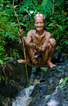 way of life: MENTAWAI PEOPLE, WEST SUMATRA, SIBERUT ISLAND, INDONESIA - 03 OKTOBER 2011: Man Mentawai tribe in the jungle. Editorial