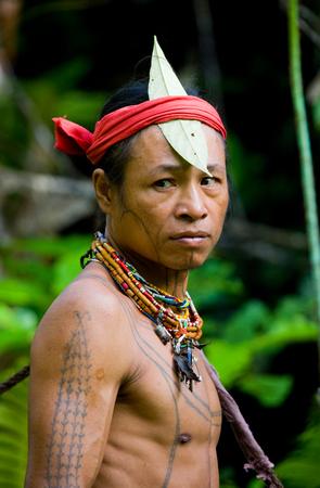 MENTAWAI PEOPLE, WEST SUMATRA, SIBERUT ISLAND, INDONESIA - 16 NOVEMBER 2010: Portrait of a man Mentawai tribe. Close-up.