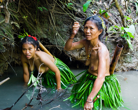 MENTAWAI PEOPLE, WEST SUMATRA, SIBERUT ISLAND, INDONESIA - 16 NOVEMBER 2010: Women Mentawai tribe fishing.