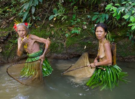 MENTAWAI PEOPLE, WEST SUMATRA, SIBERUT ISLAND, INDONESIA - 16 NOVEMBER 2010: Women Mentawai tribe fishing.
