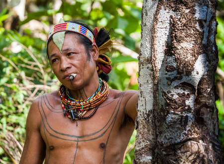 MENTAWAI PEOPLE, WEST SUMATRA, SIBERUT ISLAND, INDONESIA - 16 NOVEMBER 2010: Portrait of a man Mentawai tribe. Close-up.