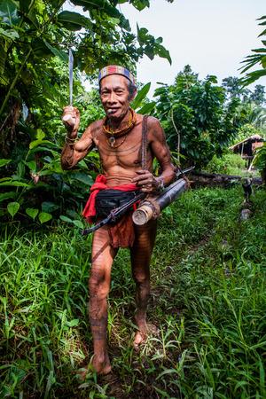 going in: MENTAWAI PEOPLE, WEST SUMATRA, SIBERUT ISLAND, INDONESIA - 16 NOVEMBER 2010: Man Mentawai tribe is going in the jungle.
